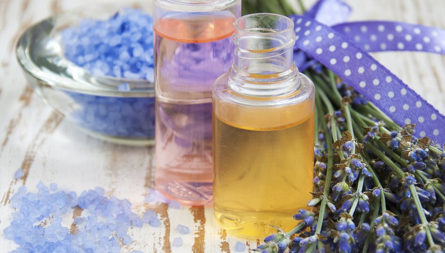 Homemade beauty products on a table with fresh lavender.