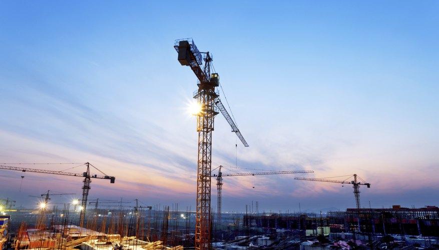 Wide shot of construction cranes