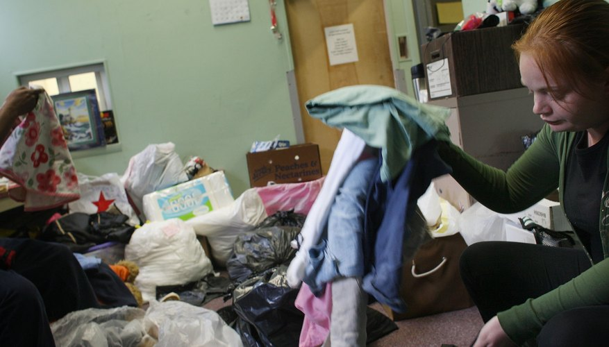 A teenager sorts through donations at a homeless shelter.