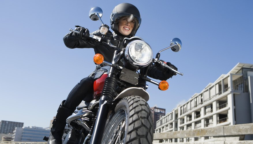Woman riding motorcycle in city