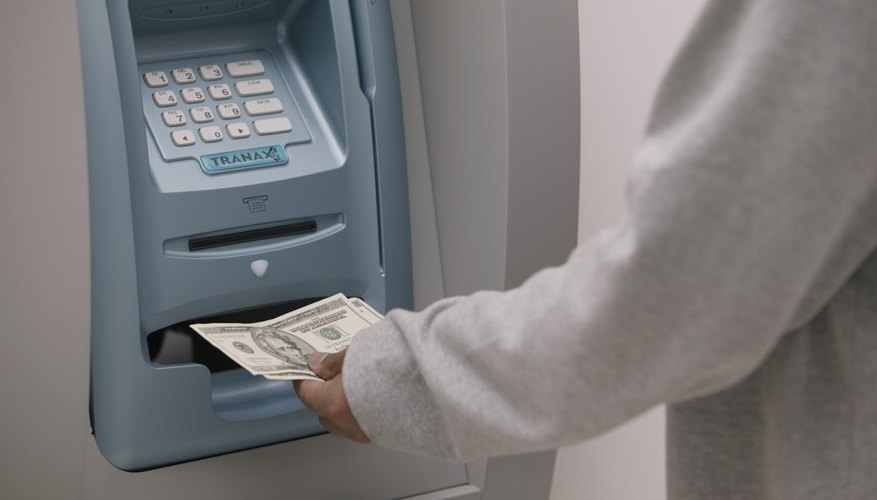 Man receiving money from an ATM.