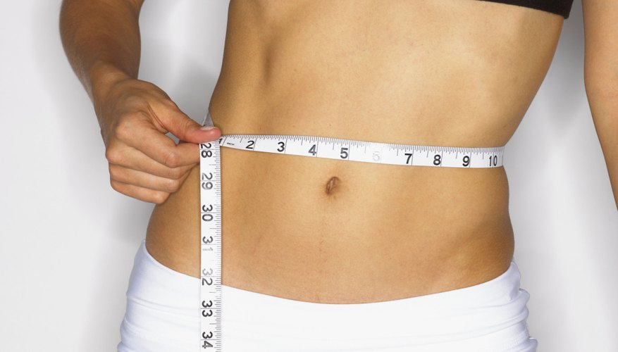 Woman measuring her stomach