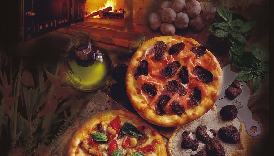Pizza's are common foods cooked in a brick oven