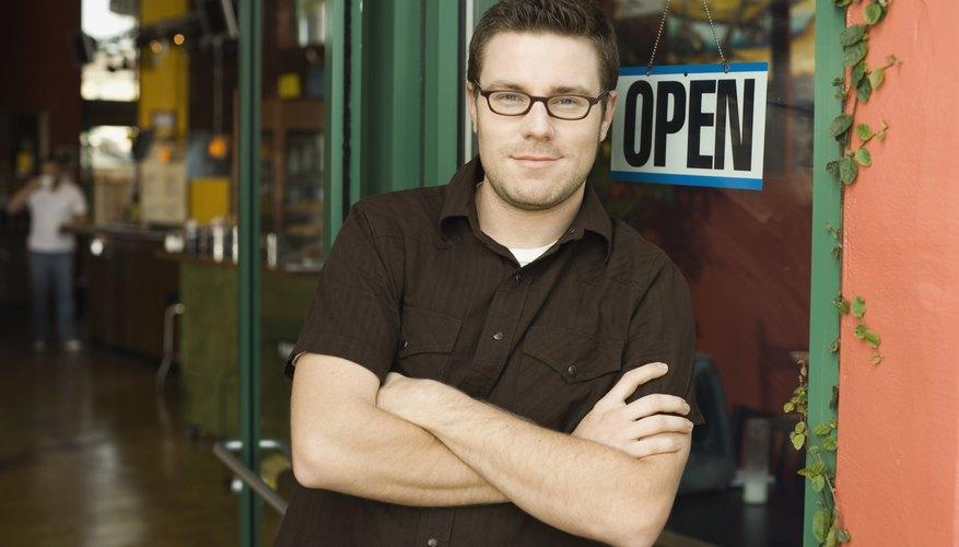Man standing in doorway of coffee shop