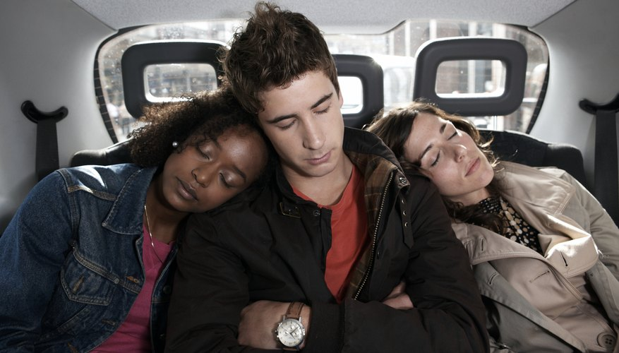 Friends alseep in back of taxi