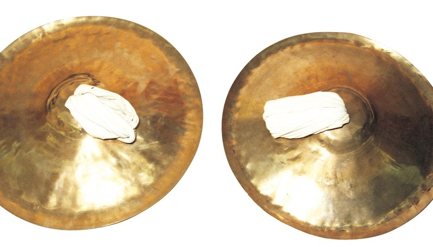 Children can make their own set of cymbals at home.