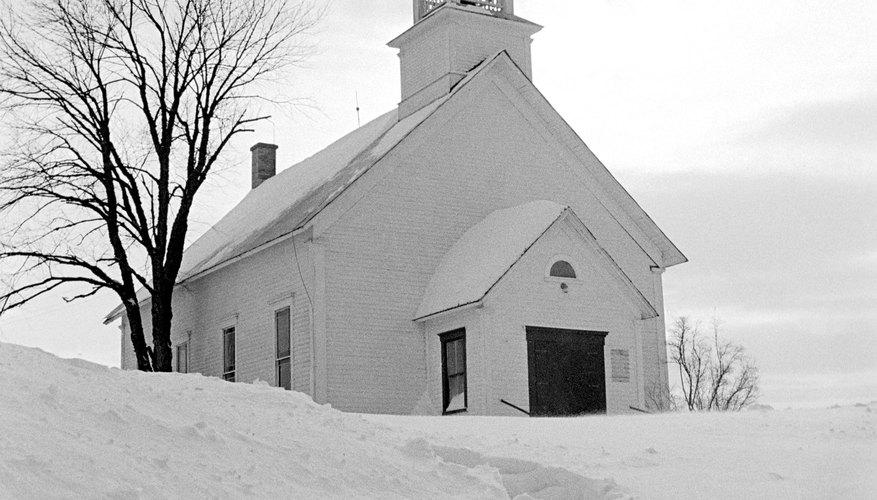 Quaint church with footprints in snow