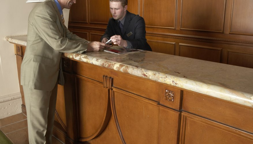Businessman with receptionist at hotel reception