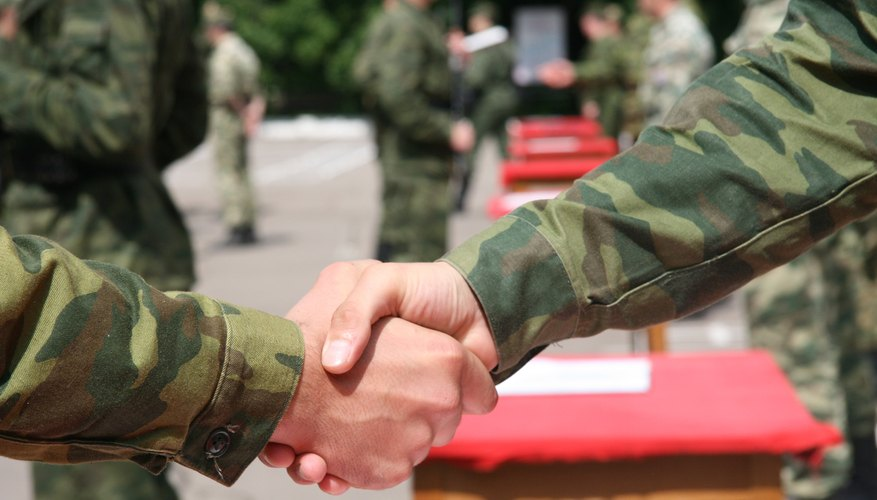 Soldiers shaking hands.