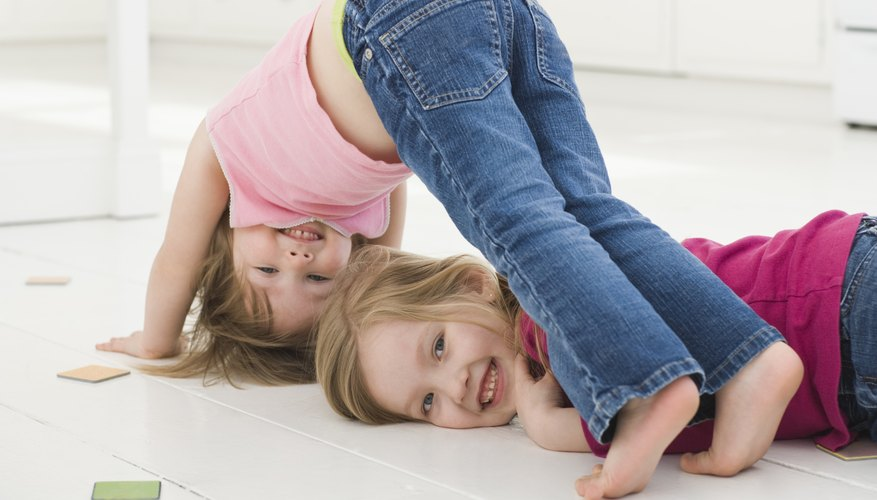 Young children enjoy rough and tumble play.