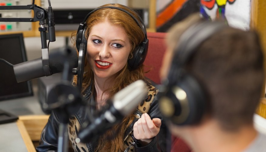 Attractive happy radio host interviewing a guest