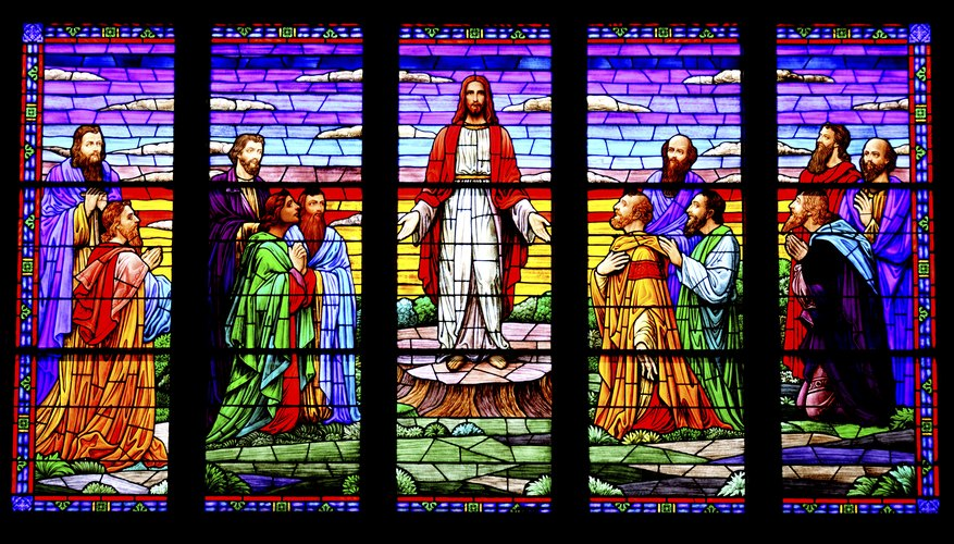 Stained glass window depicting Jesus and other religious figures