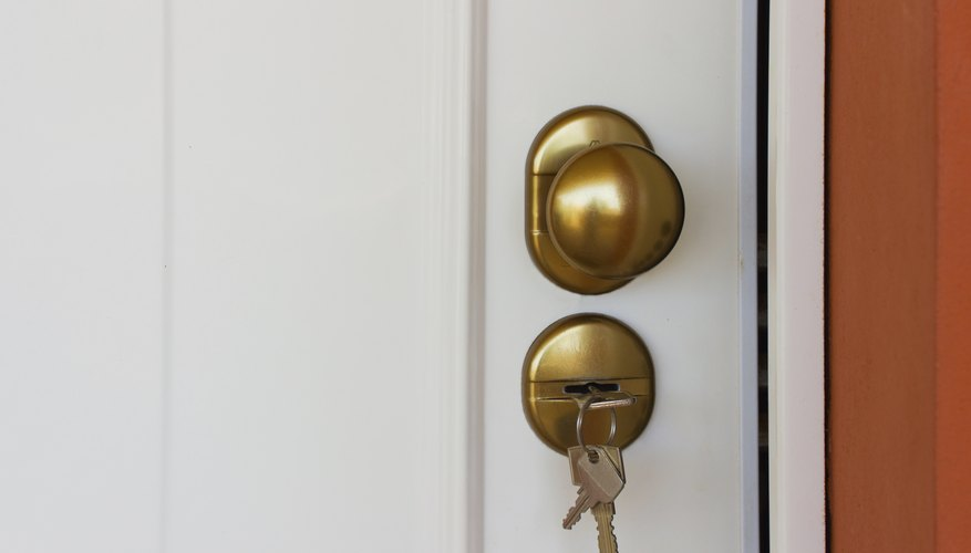 A close-up of keys in an apartment door.