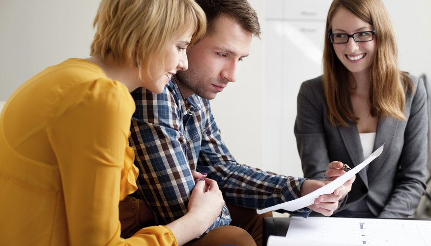 Young couple looking at mortgage statement.