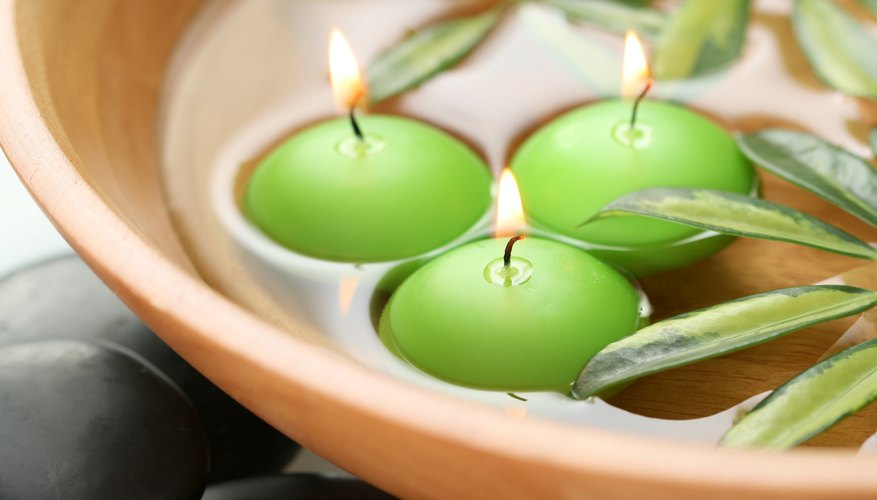 Place floating candles in a bowl of water for a beautiful display.