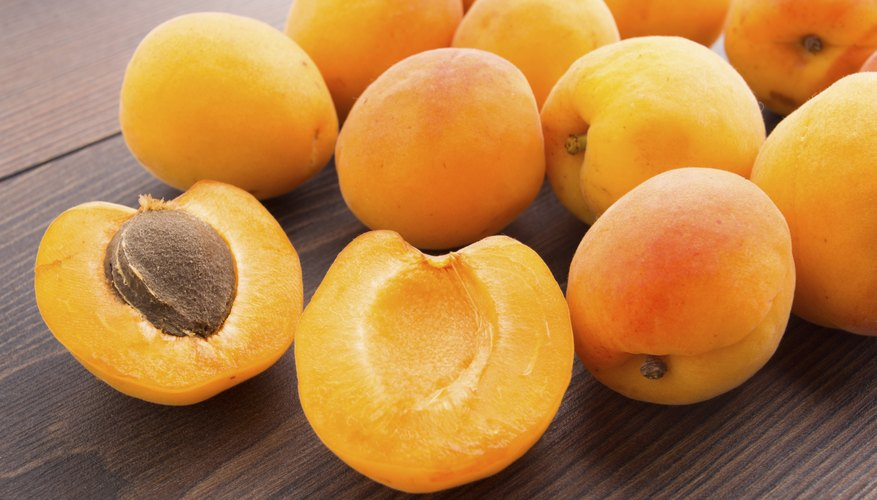 Fresh apricots on a wooden table