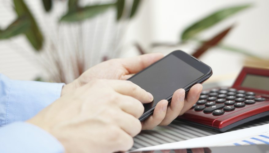 businessman in office working with smart phone, digital tablet