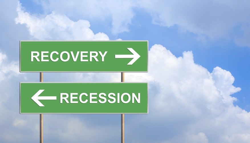 recovery and recession on green road sign