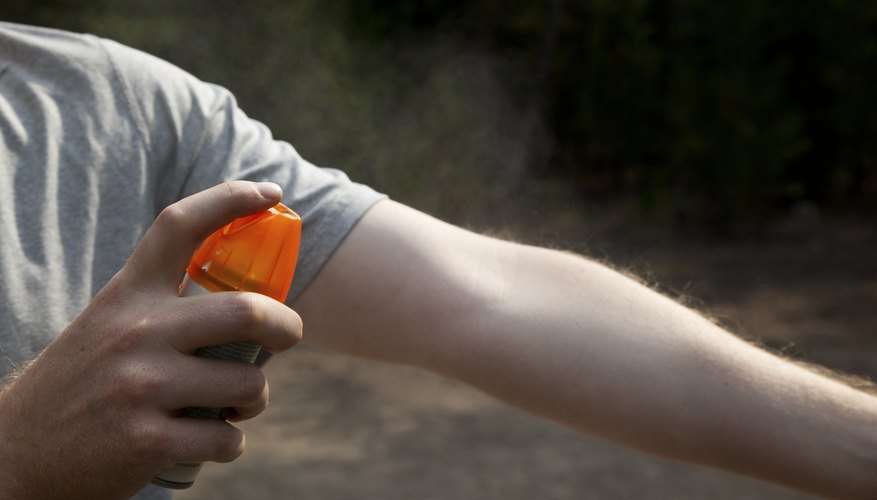 Insect repellent sprayed on arm