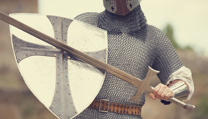 Costume with chainmail, shield, and sword.