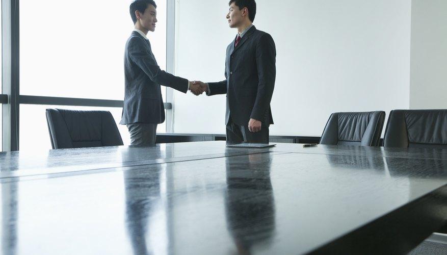 Businessmen shaking hands in meeting room