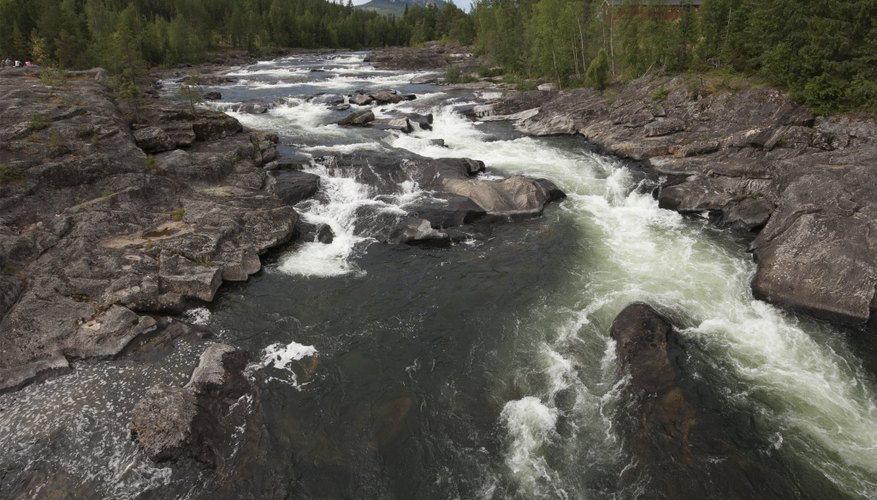 Water flows over rocks in a river.