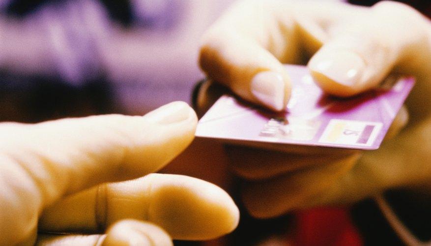 Handing over a debit card.