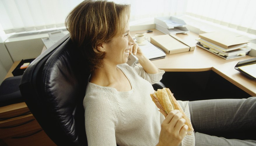 Woman having lunch break in office