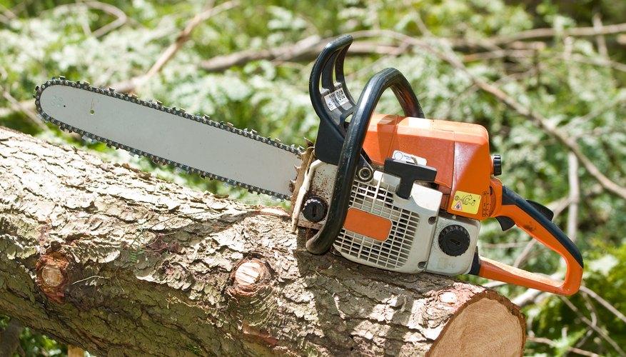 Chainsaw on fallen tree