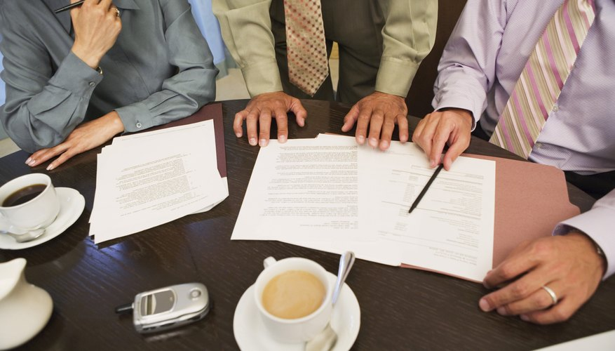 Business professionals reviewing paperwork