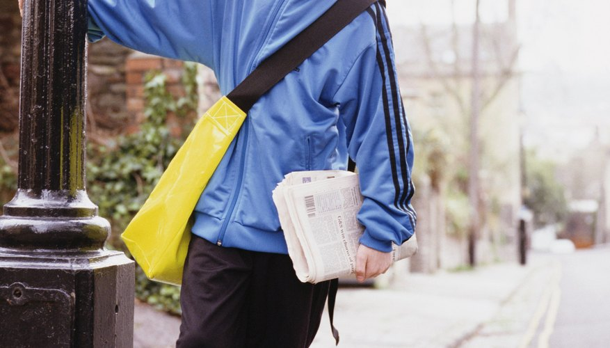 Your child may need to file a tax return for his paper route income.