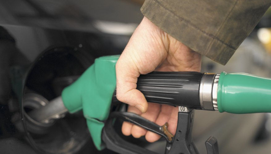 close-up of a person's hand holding a fuel pump
