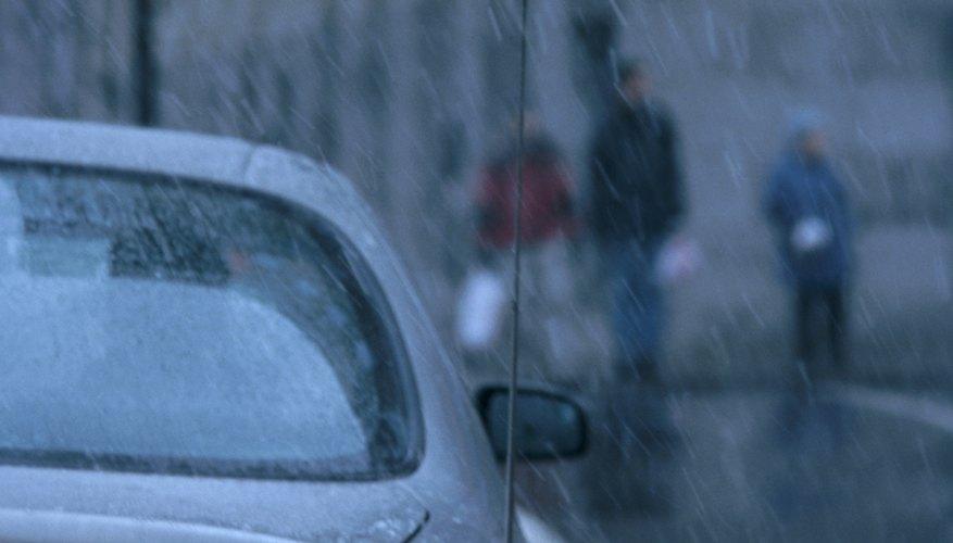 Car with turn signal in rain