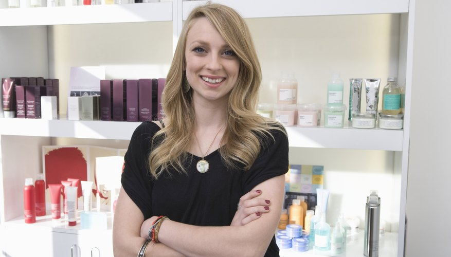 Woman standing in front of assortment of salon products