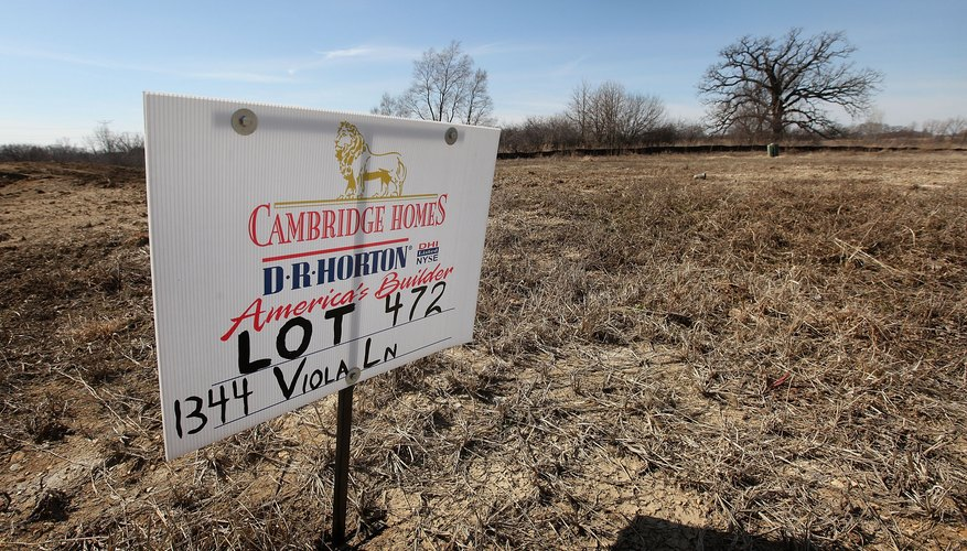 A sign advertising a vacant lot for sale.