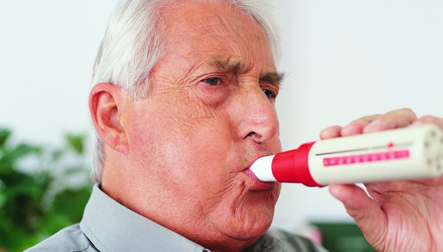 Man testing breathing with a spirometer