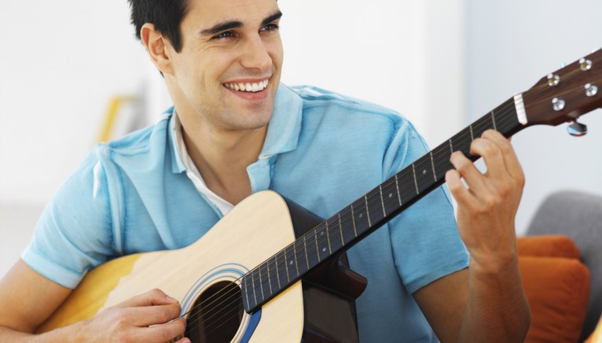 Front view of young man playing guitar