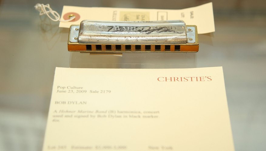 Bob Dylan's harmonica on display at an auction.