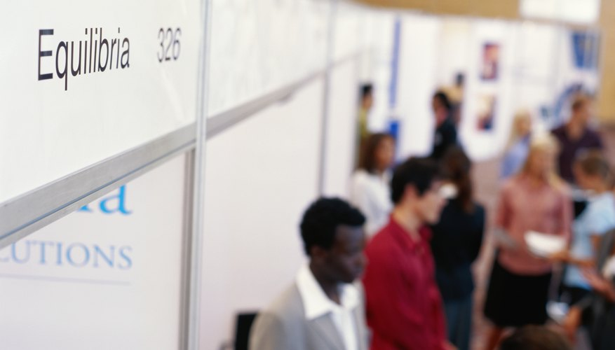 Businesspeople at exhibition, elevated view