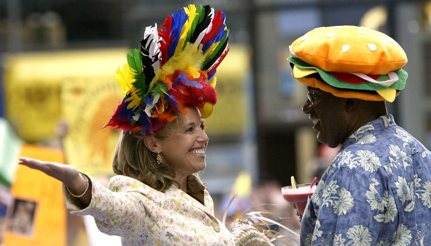 Katie Couric and Al Roker wear parrothead headgear for a 'Today' show.