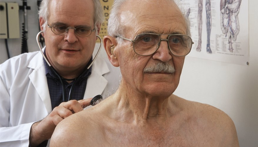 Elderly patient being examined by a doctor.