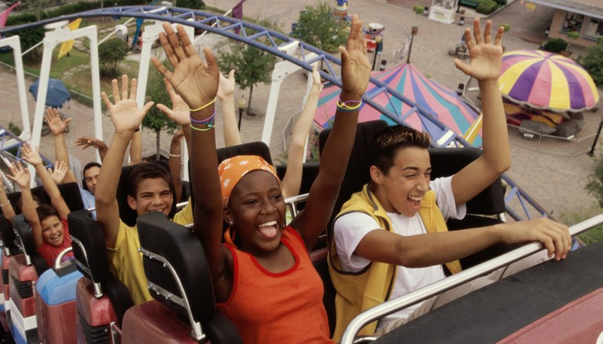 Teenage boys and girls on a roller coaster ride