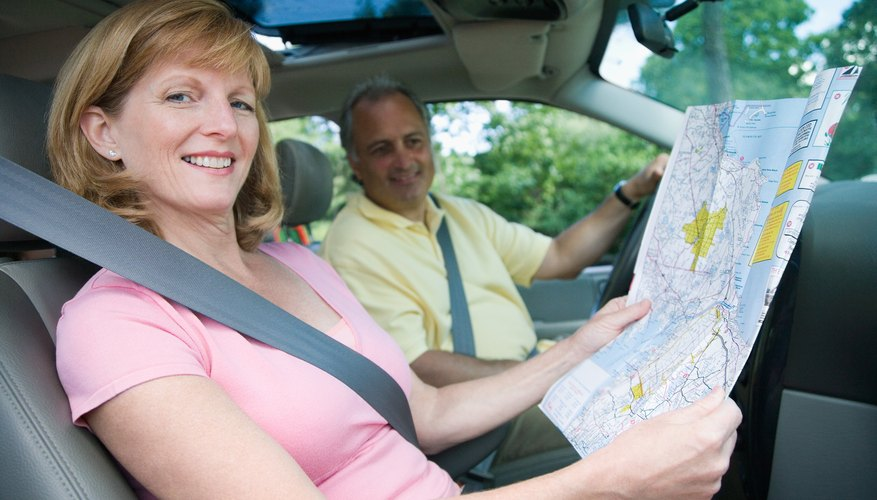 Couple posing in vehicle with map