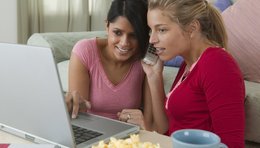 Women with laptop talking on phone