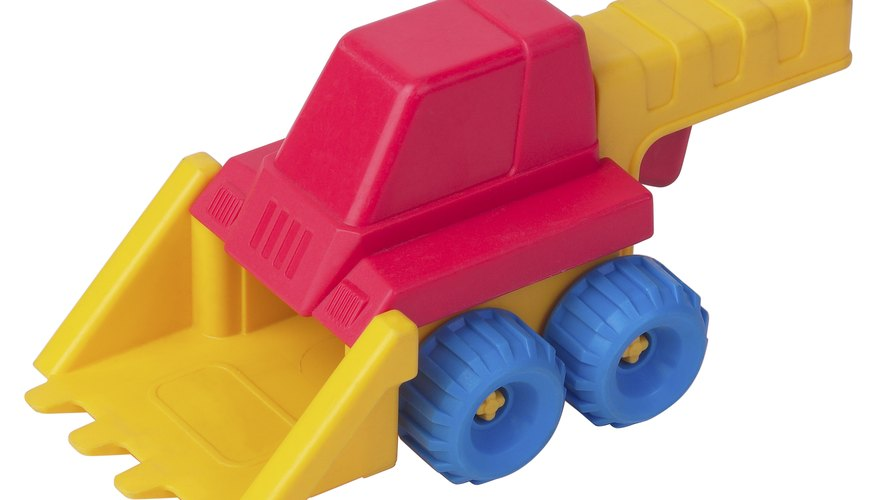 Tu niño puede aprender jugando con excavadoras de juguete.