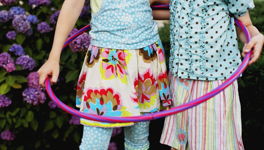 Children standing together in hula hoop