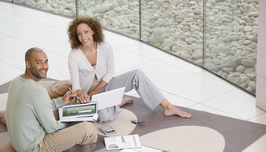 African businesspeople working on floor