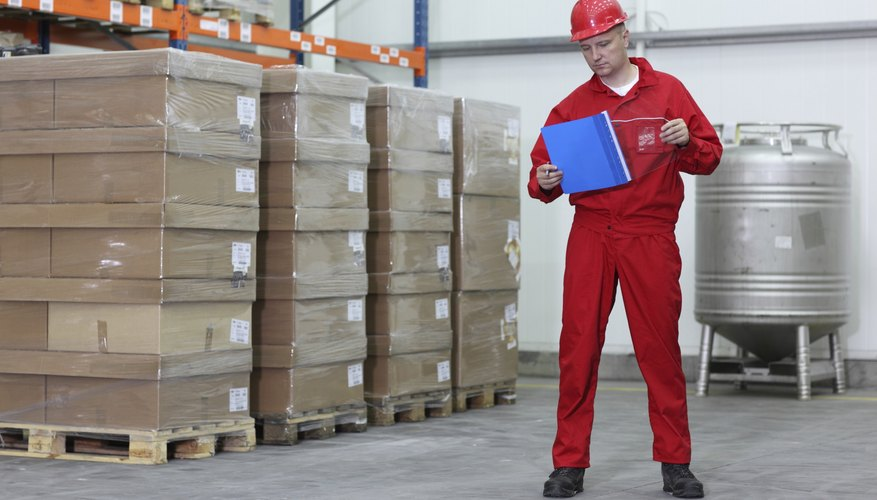 worker checking list of products