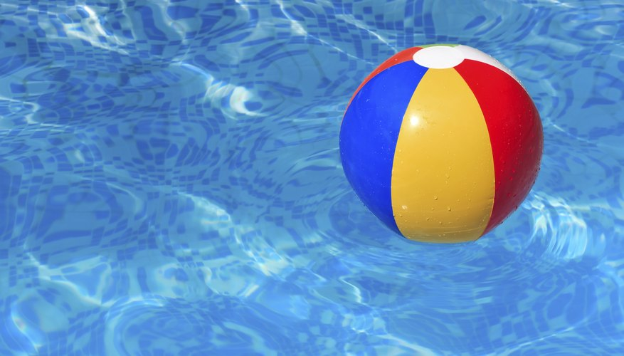 A beach ball in a swimming pool