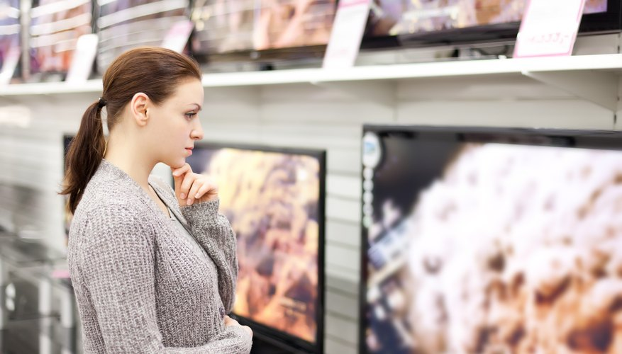 Woman shopping for wide screen television
